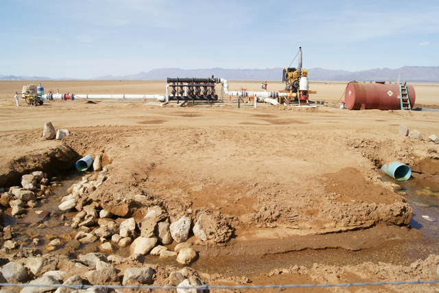 A well is seen on Jim Rhodes' farm about 20 miles north of Kingman, Ariz. Friday, March 28, 2014. The builder has left his hammer in Las Vegas and taken up farming on portions of his holdings in n ...