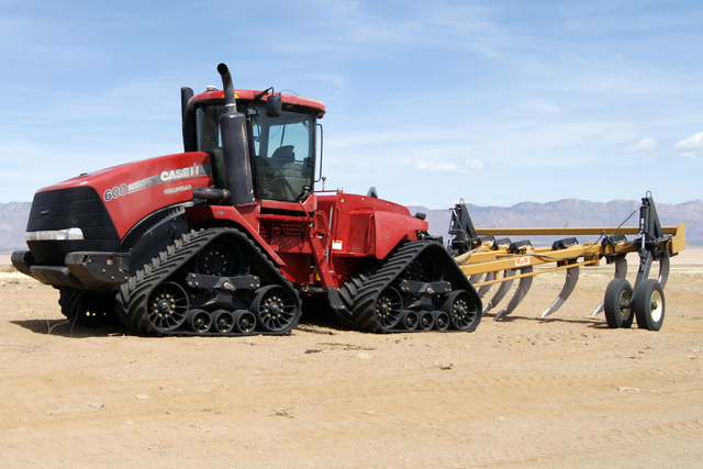 Farm equipment is seen on Jim Rhodes' farm about 20 miles north of Kingman, Ariz. Friday, March 28, 2014. The builder has left his hammer in Las Vegas and taken up farming on portions of his holdi ...