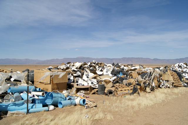 Farm supplies and trash are seen on Jim Rhodes' farm about 20 miles north of Kingman, Ariz. Friday, March 28, 2014. The builder has left his hammer in Las Vegas and taken up farming on portions of ...