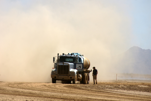 A water truck is seen on Jim Rhodes' farm about 20 miles north of Kingman, Ariz. Friday, March 28, 2014. The builder has left his hammer in Las Vegas and taken up farming on portions of his holdin ...