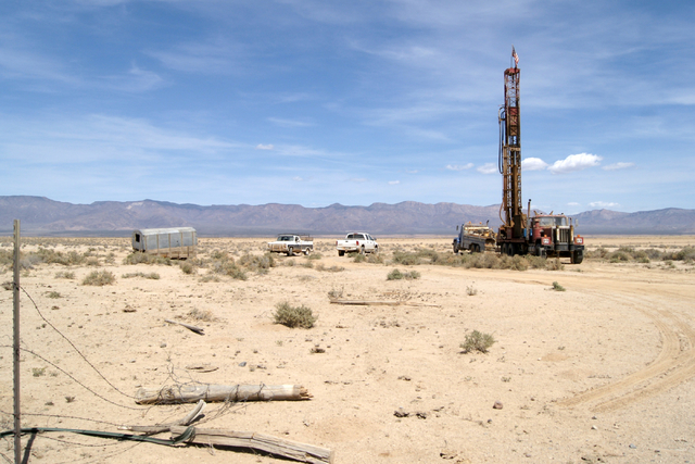 A well driller is seen on Jim Rhodes' farm about 20 miles north of Kingman, Ariz. Friday, March 28, 2014. The builder has left his hammer in Las Vegas and taken up farming on portions of his holdi ...