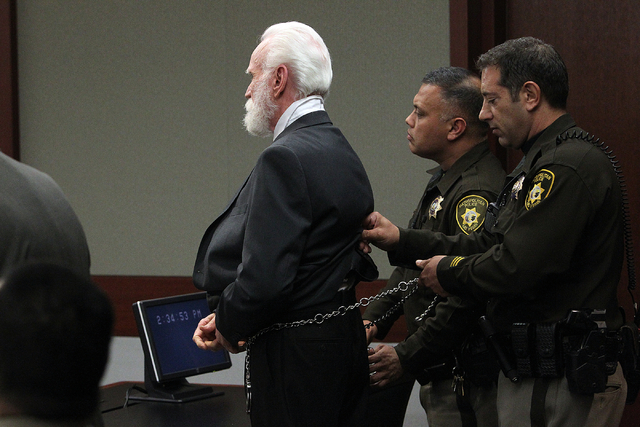 Certified nursing assistant Steven Farmer, center, is shackled after guilty verdicts were read in the courtroom of District Judge Carolyn Ellsworth in the Regional Justice Center in Las Vegas Frid ...