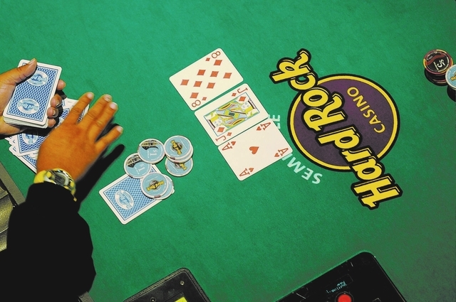 FRIDAY FEBRUARY 3, 2012 HOLLYWOOD, FL - A dealer deals for  poker players play in the poker room at the Seminole Hard Rock Hotel and Casino in Hollywood, Fl. (Josh Ritchie/Special to the Las Vegas ...