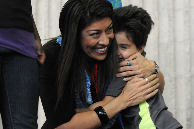 Assemblywoman Lucy Flores hugs her 4-year-old nephew Sean Andrew Bleu Bordens following her candidacy announcement for lieutenant governor of Nevada during an event at the College of Southern Neva ...