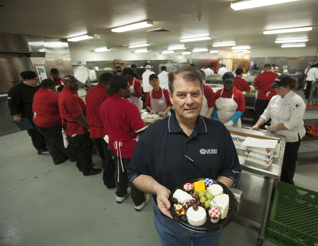 Levy Restaurants director Larry Ferguson holds a cheese platter in the Levy Restaurants kitchen at  Las Vegas  Motor Speedway on Thursday. The restaurant is making more creative, higher-end food i ...