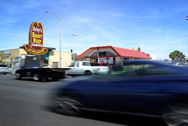 Vehicle traffic along S. Decatur Blvd. passes in front of an Arby's restaurant on Friday, March 28, 2014. (David Becker/Las Vegas Review-Journal)