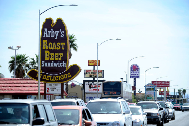 Vehicle traffic along South Decatur Boulevard passes in front of an Arby's restaurant on Friday, March 28, 2014. (David Becker/Las Vegas Review-Journal)