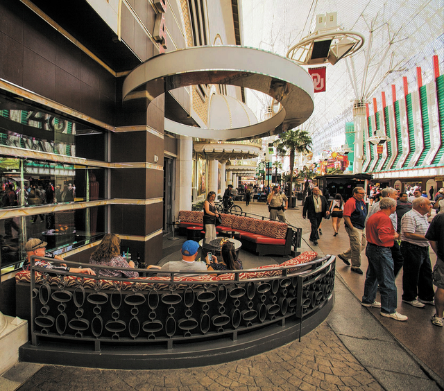 Patrons gathers at the  outside the Golden Nugget  hotel/casino bar on Friday, March 14, 2014. The exterior casino bars under Fremont Street Experience canopy that's pitting small casino owner Ste ...