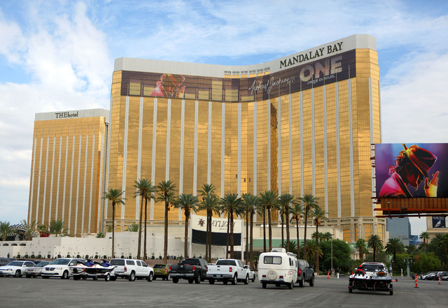 THE Hotel, left, and Mandalay Bay hotel-casino are shown Tuesday, Sept. 10, 2013, in Las Vegas. (Ronda Churchill/Las Vegas Review-Journal, File)