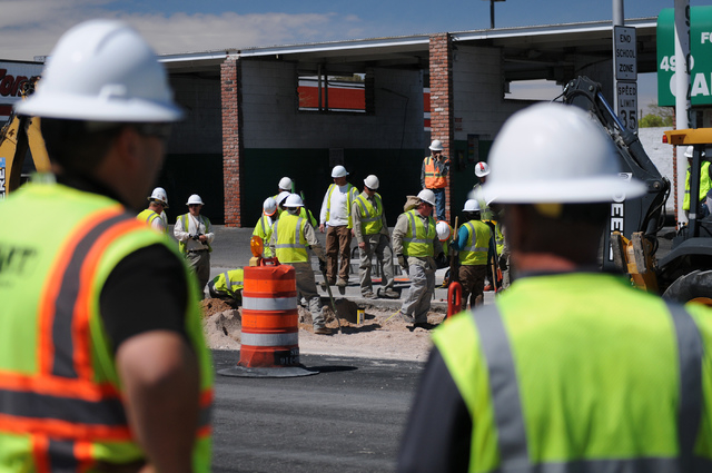 Construction crews with Southwest Gas and ELM Locating and Utility Services work to repair a gas leak at the corner of Decatur Boulevard and Vegas Drive in Las Vegas Monday, March 31, 2014. (Erik  ...