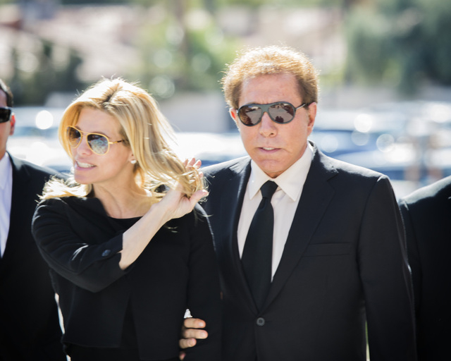 Steve Wynn, with his wife, Andrea, are shown arriving for the funeral for casino pioneer Jackie Gaughan on Monday. An SEC filing by Wynn Resorts Ltd. on Thursday shows changes in Steve Wynn's comp ...