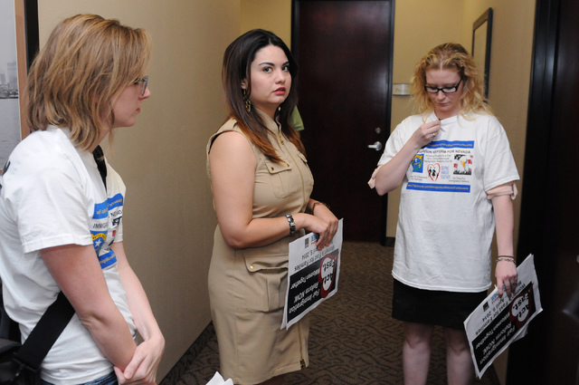 Immigration Reform for Nevada supporters Katelyn Franklin, from left, Vanessa Becerra-Bautista and Emily Ross, wait outside of the office of U.S. Rep. Joe Heck, R-Nev., in protest of the Congress  ...