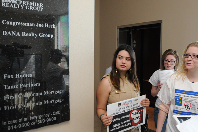 Immigration Reform for Nevada supporters Vanessa Becerra-Bautista, from left, Katelyn Franklin, and Emily Ross, are seen during a fasting event as they walk toward the office of U.S. Rep. Joe Heck ...
