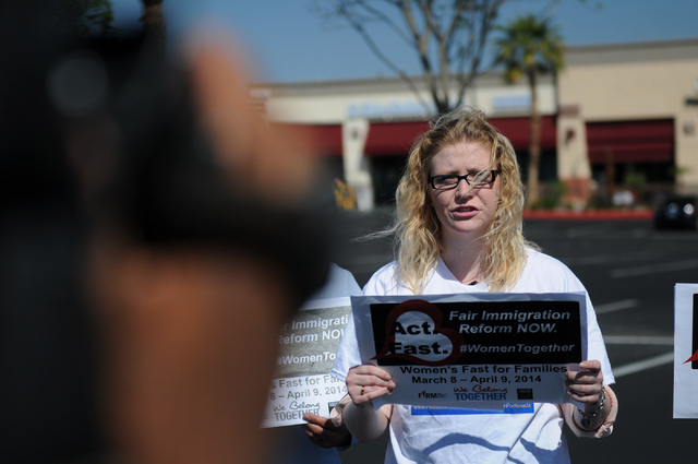 Emily Ross, spokeswoman with Immigration Reform for Nevada, gives a speech to the media during a fasting event outside of the office of U.S. Rep. Joe Heck, R-Nev., in protest of the Congress not t ...