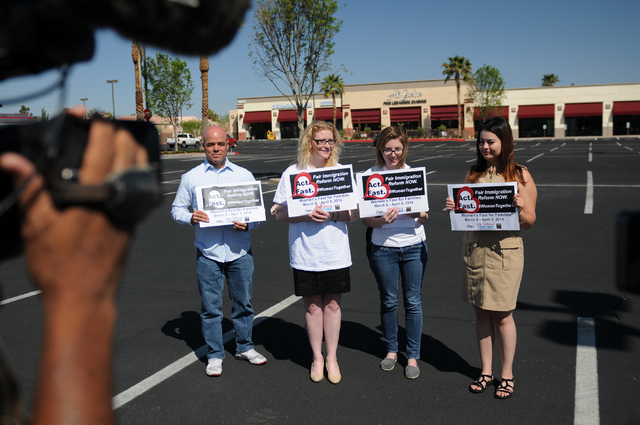 Immigration Reform for Nevada supporters Robert Telles, from left, Emily Ross, Katelyn Franklin and Vanessa Becerra-Bautista, are interviewed during a fasting event outside of the office of U.S. R ...