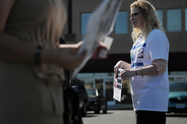 Emily Ross, spokeswoman with Immigration Reform for Nevada, is interviewed during a fasting event outside of the office of U.S. Rep. Joe Heck, R-Nev., in protest of the Congress not taking action  ...