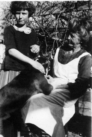 Helen J. Stewart, left, pets a dog that has climbed up into the lap of her grandmother and namesake, Las Vegas pioneer Helen J. Stewart, in this photo from between 1923 and 1924. The younger Helen ...
