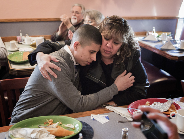 Thelma Martinez Soto, right, hugs her son Bryan Rivera, 20, after he spoke during the Hispanics in Politics breakfast at Dona Maria Tamales Mexican Restaurant on Wednesday. Martinez, a victim of d ...