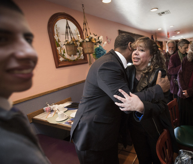 U.S. Rep. Steven Horsford, D-Nev., center, hugs Thelma Martinez Soto after the Hispanics in Politics breakfast at Dona Maria Tamales Mexican Restaurant on Wednesday. Her son Bryan Rivera, 20, is s ...