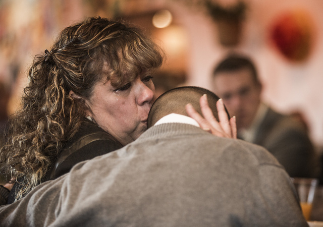 Thelma Martinez Soto, left, kisses her son Bryan Rivera, 20, after he spoke during the Hispanics in Politics breakfast Wednesday at Dona Maria Tamales Mexican Restaurant. Martinez, a victim of dom ...
