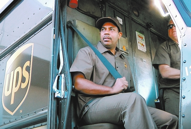 Rep. Steve Horsford, D-Nev., spends the morning as a UPS delivery person for his district in Las Vegas. February 21, 2014.  (Michael Quine/Las Vegas Review-Journal)