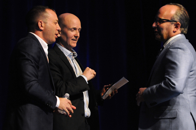 Debate moderator Steve Lipscomb, center, founder of World Poker Tour, watches as Mitch Garber, left, CEO at Caesars  Acquisition Co. and Caesars Interactive Entertainment, and Andy Abboud, vice pr ...