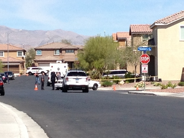 Police tape marks off a residential area  where North Las Vegas homicide detectives investigate a homicide in the 6100 block of Stibor Street, near Tropical Parkway and Lamb Boulevard. (Cassandra  ...