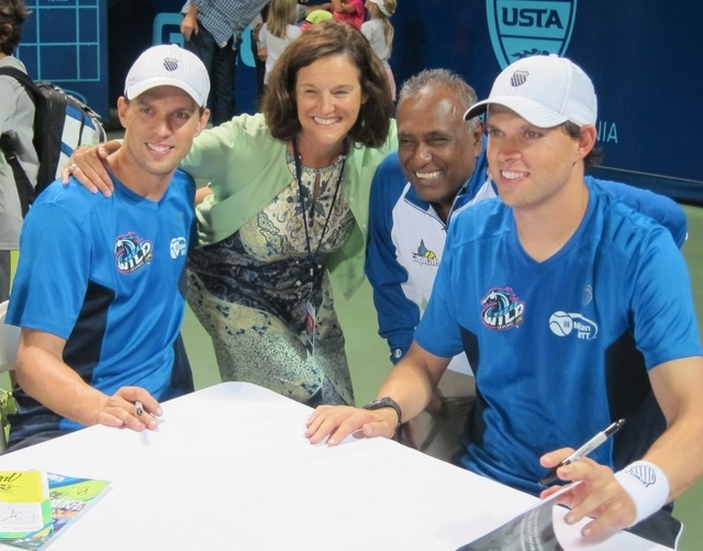 Mike Bryan (left) and Bob Bryan pose with Betsy and Deepal Wannakuwatte -- owners of Sacramento Capitals at that time -- while signing autographs after a tennis match. Deepal Wannakuwatte, who own ...