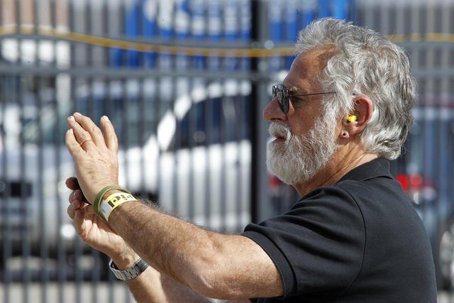 """Johnathan Goldsmith, whose latest role is """"The Most Interesting Man in the World,"""" takes a photo near pit row at the Kobalt 400 at the Las Vegas Motor Speedway on Sunday. (Justin Yurkanin/Las Vega ..."""