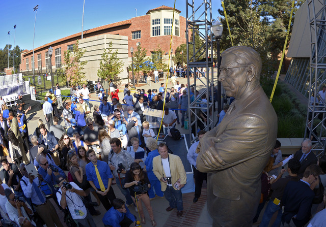 Onlookers view a statue of legendary UCLA men's basketball coach John Wooden after its unveiling outside Pauley Pavilion at UCLA on Oct. 26, 2012, in Los Angeles. (AP Photo/Mark J. Terrill file)