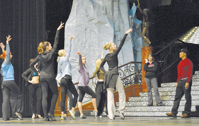 """Frank Gatson Jr., """"Jubilee!"""" director and choreographer, right, and company manager Diane Palm, on stairs, watch as dancers go through some moves during a rehearsal at the Jubilee Theater in Bally ..."""