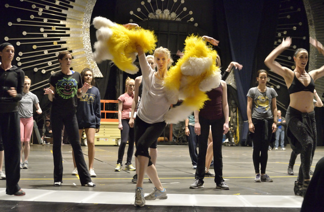 """Dance captain Cathy Colbert, with yellow boa, leads cast members through some moves during a rehearsal for """"Jubilee!"""" at the Jubilee Theater in Bally's. The revamped show reopens Monday with a gra ..."""