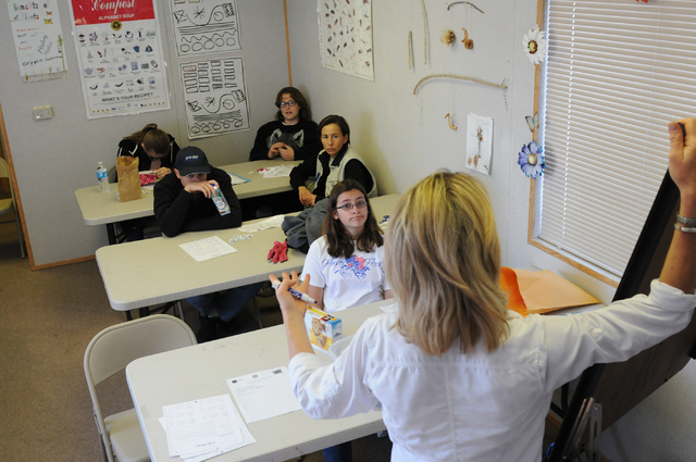 Lisa Vargas, class facilitator at the Cooperative Extension's Junior Master Gardener program, lectures students about nutrition and the importance of reading food labels during a class at the Clar ...