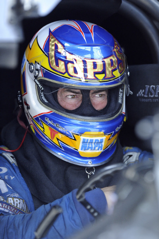 NHRA Funny Car driver Ron Capps sits in his car in the staging lanes during the final qualifying session for the SummitRacing.Com Nationals at The Strip at Las Vegas Motor Speedway in Las Vegas Sa ...