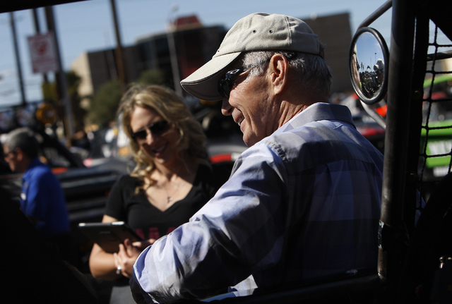 Racing legend Parnelli Jones, right, talks with some fellow drivers before leading the Mint 400 Parade of Vehicles out of the Circus Circus parking lot in Las Vegas on March 12, 2014. Jones is onl ...