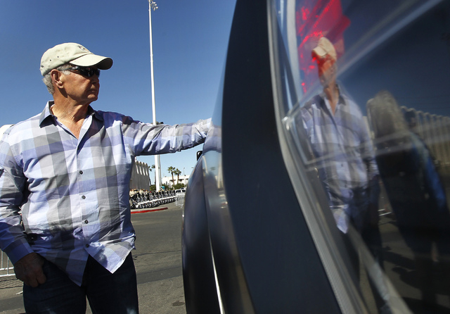 Racing legend Parnelli Jones hangs out before leading the Mint 400 Parade of Vehicles out of the Circus Circus parking lot in Las Vegas on March 12, 2014. Jones is only one of two drivers in histo ...