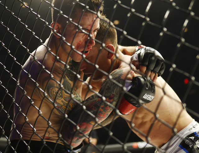 Iraq War veteran Shane Kruchten, left, takes on fellow veteran Mike Corey during their World Series of Fighting mixed martial arts bout at the Hard Rock Hotel and Casino in Las Vegas on March 29,  ...