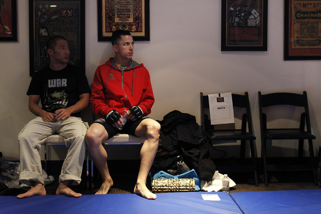 Iraq War veteran Shane Kruchten, right, waits backstage with his friend and training partner Victor Chen before taking on fellow veteran Mike Corey for their World Series of Fighting mixed martial ...