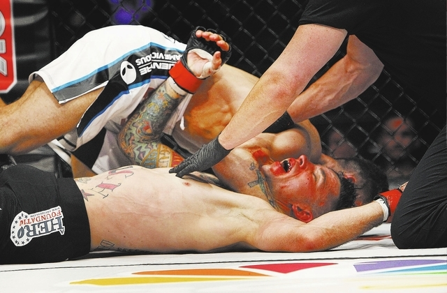 Iraq War veteran Shane Kruchten loses by submission against fellow veteran Mike Corey during their World Series of Fighting mixed martial arts bout at the Hard Rock Hotel and Casino in Las Vegas o ...