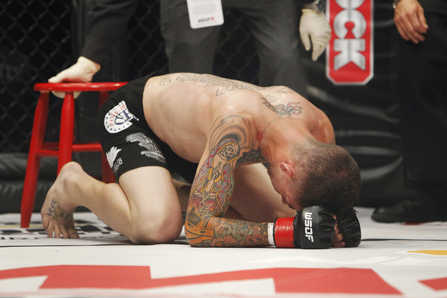 Iraq War veteran Shane Kruchten reacts after losing to fellow veteran Mike Corey during their World Series of Fighting mixed martial arts bout at the Hard Rock Hotel and Casino in Las Vegas on Mar ...