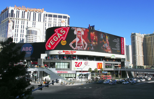Branded Cities Network, which owns the 60-foot-tall sign at Harmon Corner, wants to sell rights to put an entity's name atop the sign that measures 306 feet across. (Jerry Henkel/Las Vegas Revie ...