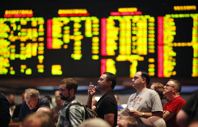 People wait in line to bet on the NCAA basketball tournament in the sports book at The Mirage in Las Vegas Thursday, March 20, 2014. (John Locher/Las Vegas Review-Journal)