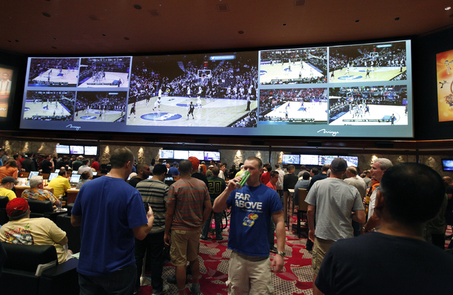 NCAA basketball tournament games are seen on screens in the sports book at The Mirage in Las Vegas Thursday, March 20, 2014. (John Locher/Las Vegas Review-Journal)