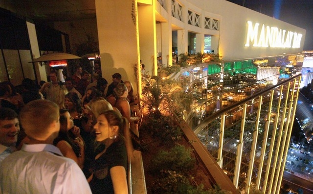 A crowd packs the patio overlooking a view of the Las Vegas Strip from the House of Blues Foundation Room at Mandalay Bay. An investigation into narcotics and prostitution at the Foundation Room h ...