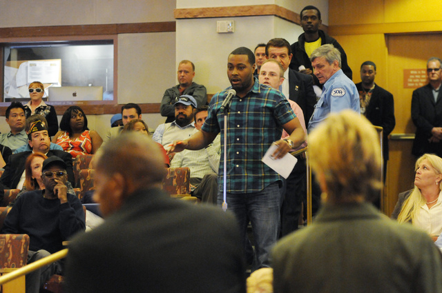 Devin Brooks asks a question during a public meeting on a new ordinance that would allow dispensaries for medical marijuana in Clark County at the Clark County Government Center in Las Vegas Wedne ...