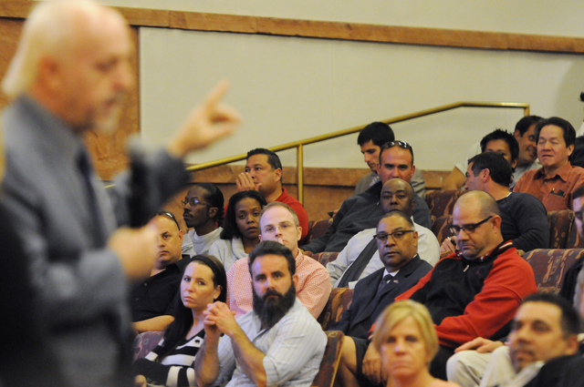Attendees listen to Michael McAuliffe, political outreach director of marijuana patient advocate group WECAN, as he speaks in favor of a new ordinance that would allow dispensaries for medical mar ...