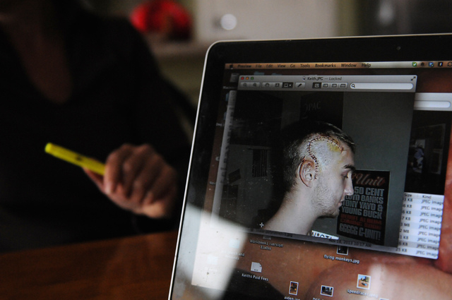 Catherine Patton shows a picture of her son Keith who sustained a head injury during an interview at his home in Las Vegas Thursday, March 20, 2014. Keith Patton claims to suffer from migraines, d ...
