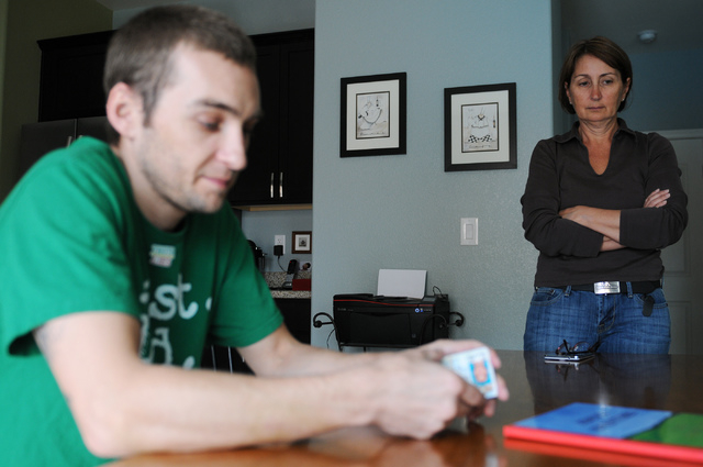 Keith Patton, left, and his mother Catherine, are interviewed at their home in Las Vegas Thursday, March 20, 2014. Patton, a medical marijuana patient, claims to suffer from migraines, dizziness a ...