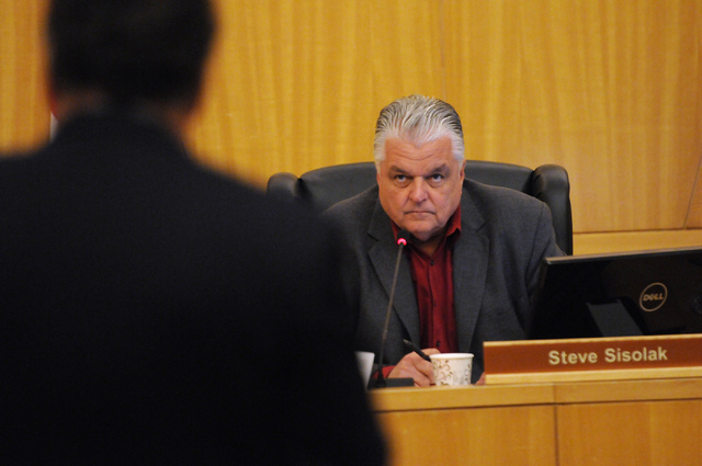 Clark County Commissioner Steve Sisolak listens to speakers during a public meeting on a new ordinance that would allow medical marijuana dispensaries in Clark County at the Clark County Governmen ...