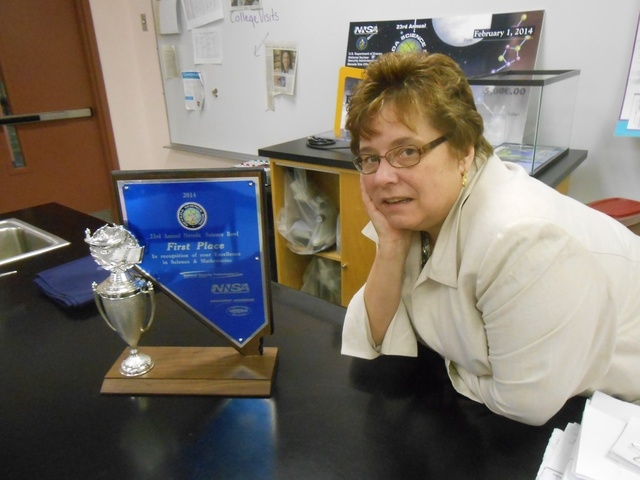 Karen Bleifuss, Science Bowl team coach and teacher at The Meadows School, shows off the team's regional trophy, Feb. 11. She said she never doubted her team would take the top spot. (Jan Hogan/View)
